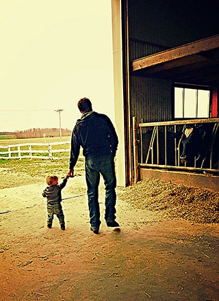 Father and son in barn